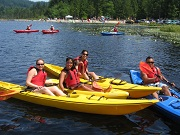 Corporate Group Posing In Kayaks